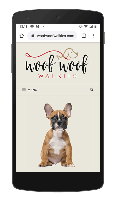 Image of Woof Woof Walkies website displayed on a mobile phone
